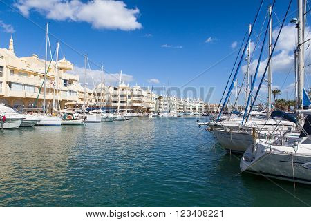 BENALMADENA, SPAIN - MARCH 5, 2016: View of Puerto Marina leisure port in a sunny day in March 5, 2016 in Benalmadena, Spain. Puerto Marina is one of the biggest leisure ports in Andalusia, and is located at Costa del Sol.