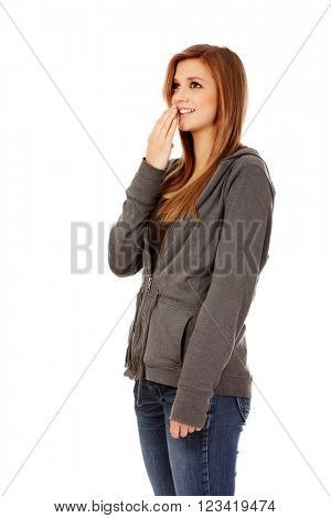 Giggles teenage woman covering her mouth with hand