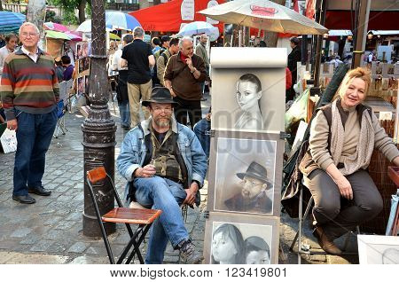 PARIS / FRANCE - September 24 2011: Artists display their work in Montmartre. Montmartre in Paris is place where many notable artists lived and worked.