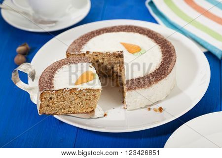 Carrot cake on a plate, single piece on cake lifter
