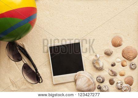 Sea Shells, Ball, Sunglasses And Polaroid Picture