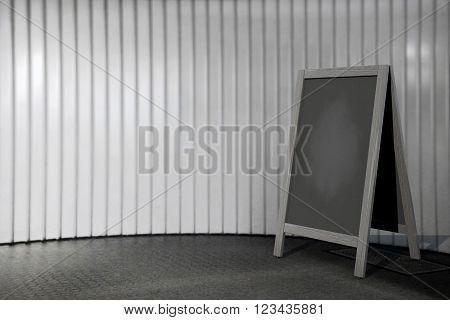 Blank Wooden Menu Blackboard Outdoor Display in front of wall. 3d Rendering