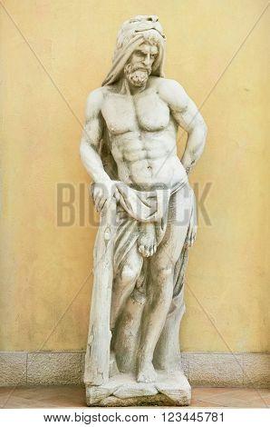 Statue of Hercules against Yellow Wall Background in Varna Bulgaria
