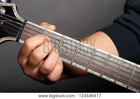 close up of a electric guitar player