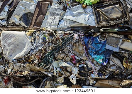 Scrap metal garbage trash compacted for recycling industrial garbage