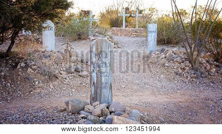 TOMBSTONE, ARIZONA - MARCH 20: A headstone marks a grave at Boot Hill Cemetery in Tombstone, Arizona on March 20th, 2016.