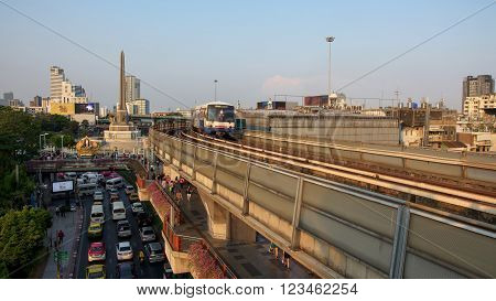BANGKOK THAILAND - MARCH 12 2016: BTS sky train on railway at Victory monument station. BTS serves 1 million transit people per day especially on working day.