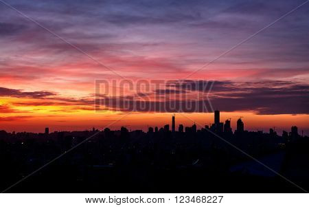 City in sunset light, silhouette of the buildings over colorful sky background, beautiful evening cityscape, Beirut, Lebanon