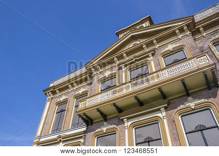 SAPPEMEER, NETHERLANDS - MARCH 26, 2016: Detail of old school building in the center of Sappemeer, Netherlands