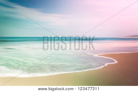 A multi-colored motion-blurred seascape with opposing light and dark vignettes.