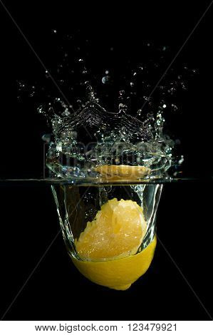 Lemon In Water On Black Background