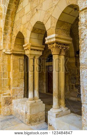 BETHLEHEM, PALESTINE - FEBRUARY 18, 2016: The stone columns and arches of the courtyard of the Church of the Nativity on February 18 in Bethlehem.