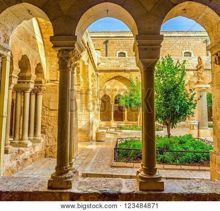 BETHLEHEM, PALESTINE - FEBRUARY 18, 2016: The view on the inner courtyard of the Church of the Nativity and the monument to the St. Jerome on February 18 in Bethlehem.