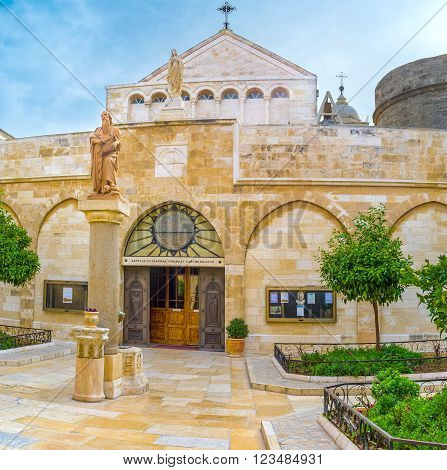 BETHLEHEM, PALESTINE - FEBRUARY 18, 2016: The view on the main entrance to the St. Catherine Church from the courtyard of the Church of the Nativity on February 18 in Bethlehem.