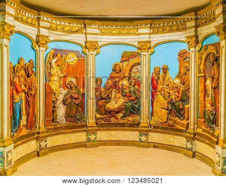 BETHLEHEM, PALESTINE - FEBRUARY 18, 2016: The beautiful tableau with Bible scenes located in altar on February 18 in Bethlehem.