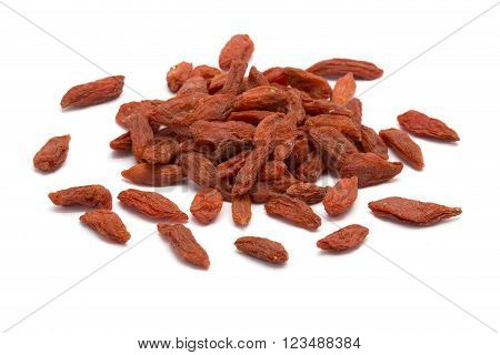 Heap of dried Goji berries on white isolated background
