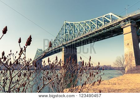 Jacques-Cartier Bridge and St-Lawrence River in Montreal at sunset