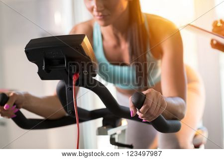 Young women doing sport biking in the gym for fitness