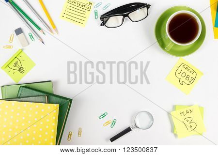 Office table desk with supplies, notepad, computer and coffee cup. Business creative consept. Copy space.