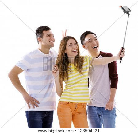 Young people taking selfie with mobile phone isolated on white