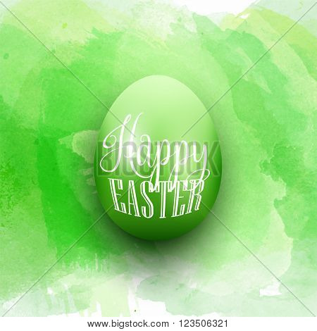 Easter egg on a green watercolor background
