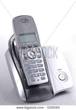 modern wireless dect phone in cradle over gray background poster