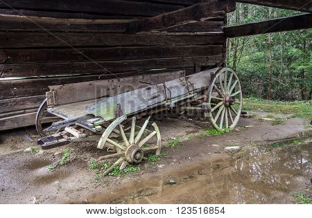 Abandoned Pioneer Wagon. Abandoned pioneer wagon left to deteriorate beside a barn. Great Smoky Mountain National Park. Gatlinburg, Tennessee.