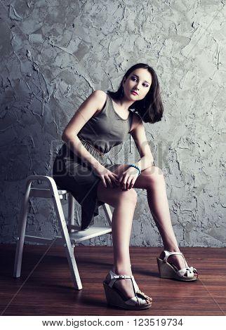 beautiful young teenage model wearing a dress  in the studio