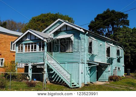 BRISBANE, AUSTRALIA, September 11: A light blue, high-set Queenslander house in Wooloowin, Brisbane, on September 11, 2011. Queenslanders are traditionally made from timber and raised on stilts.