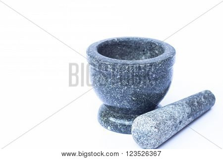 Stone mortar and pestle on white background, stock photo