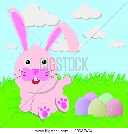 The Easter bunny playful with painted eggs