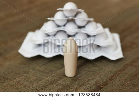 suppositories on the old wooden table; shallow depth of field