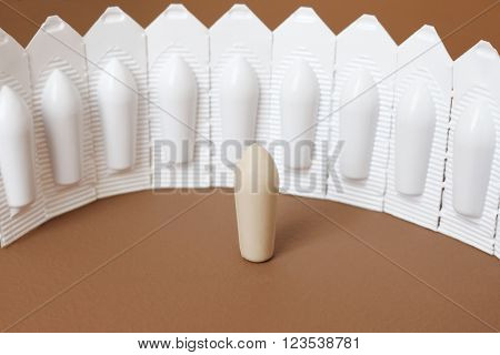 suppositories on the brown background; shallow depth of field