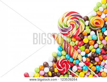 Colorful candies and lollypops. Isolated on white background with copy space