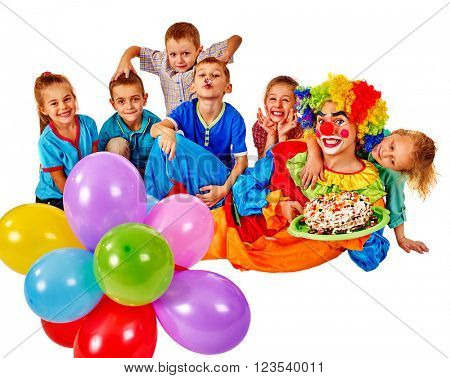 Clown keeps bunch of balloons and birthday cake with group kids. Isolated. Bithday concept.