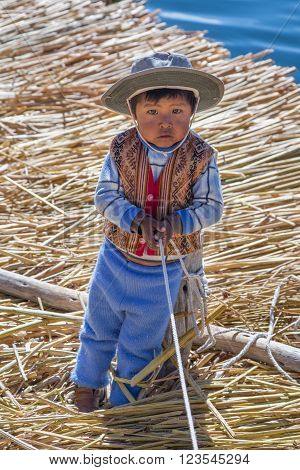 Puno, Peru - Circa June 2015: Small Boy In Traditional Clothes At Uros Floating Island And Village O