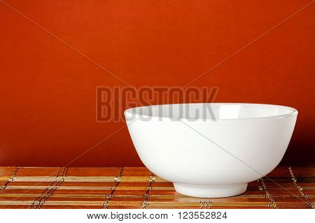 White Dishes On Bamboo Mats.