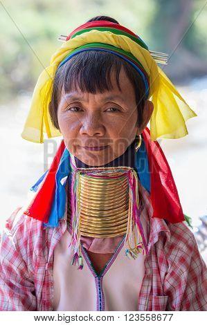 INLE LAKE MYANMAR - JANUARY 14 2016: Padaung Tribal woman poses for a photo in Inle lake Myanmar Burma The Padaung-Karen long-necked tribe women are minority of Myanmar.