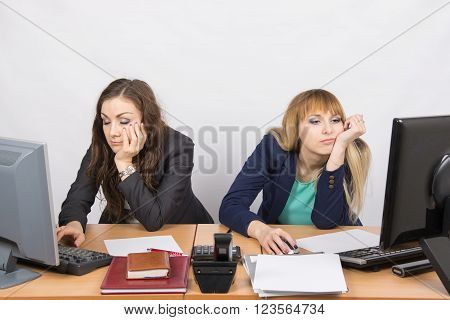 Two Young Office Employee Tired Of Working At Computers