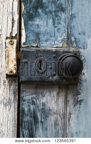 old rusty doorknob and lock on exterior door