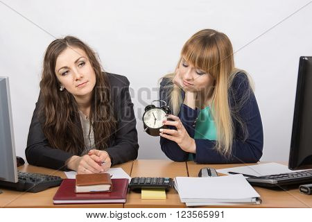 Two Tired Women In The Office Awaiting The End Of The Working Day