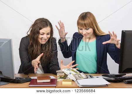 Two Office Employee Greedy Hands To Pull A Wad Of Money