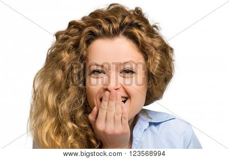 Surprised young woman with her hand on her mouth