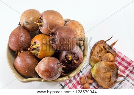 Medlar Fruit In The Bowl