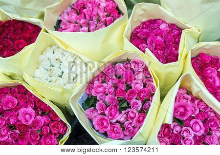 Colorful roses wrapped and displayed for sales in Pak Klong talad market Bangkok Thailand