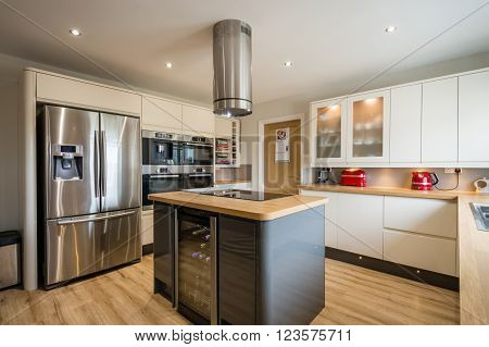 Modern kitchen with island, high gloss units and rounded corners