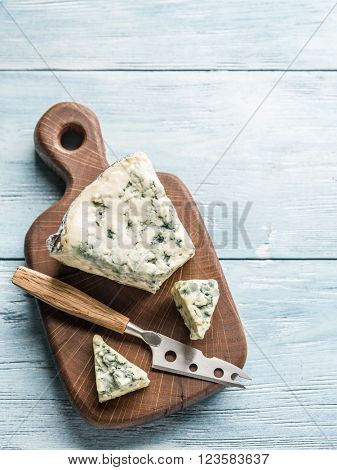 Blue cheese on a wooden board.