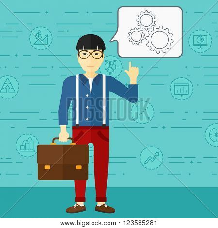 Businessman pointing at cogwheels.