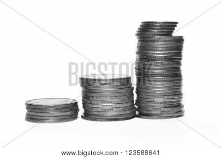 Stack of silver coins isolated on white background, black and white photo