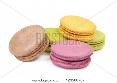 French colorful macarons isolated on white. Tasty, diet, gourmand, delicious.